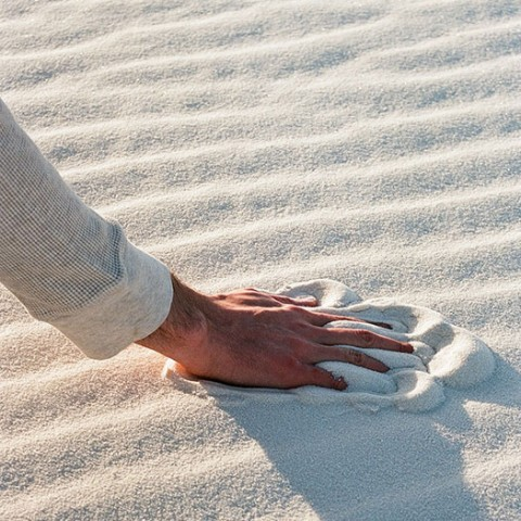 Hand in sand